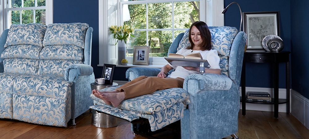 reading on riser recliner chair