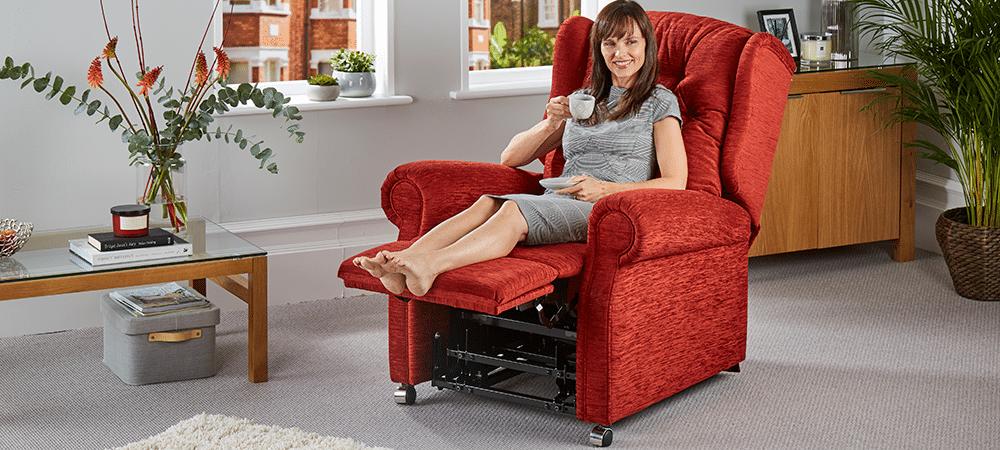 woman in riser recliner chair